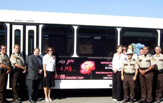 Representatives of Constable Bruce Elfant's office and Impact 3 staff with the 2008 bus ad campaign